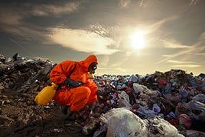 Environmentalist measuring pollution at the landfill.