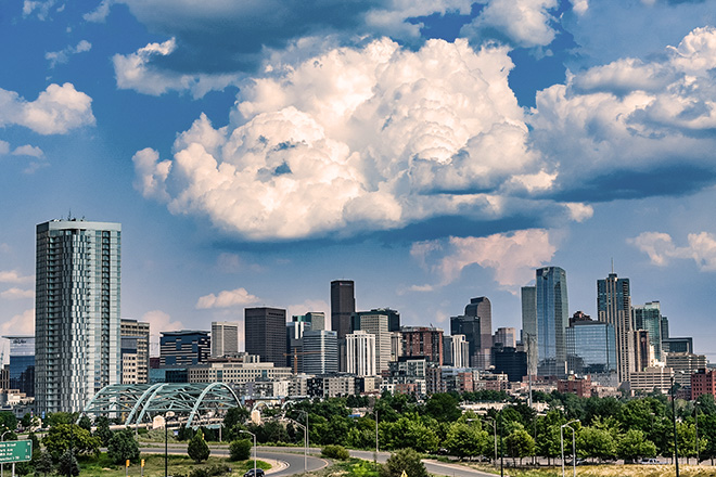 Denver, Colorado / USA - August 7, 2018: The downtown Denver skyline on a beautiful summer afternoon.