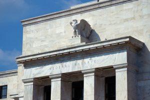 Federal Reserve building front eagle blue sky