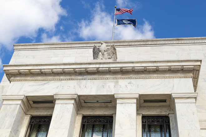 Quick view: Fed turns a page, cuts rates