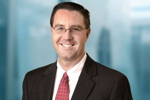 Justin Tugman | Janus Henderson Investors