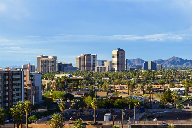 Downtown Scottsdale and suburbs of Phoenix, Arizona, with the White Tank Mountain Range in the background