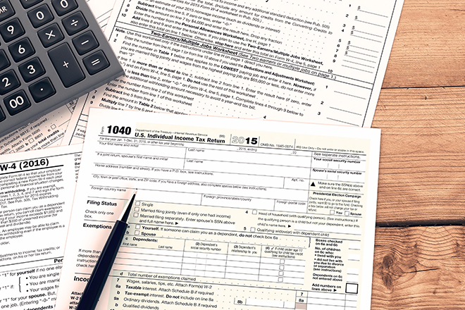 top view of forms for usa taxes with a pen and an electronic calculator, empty spaces for custom text at the right (3d render)